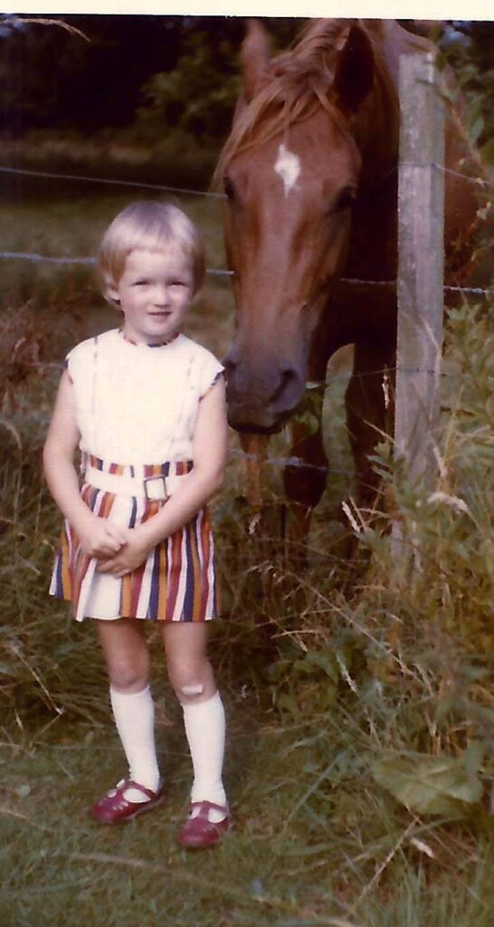 a young deryn oliver with a horse